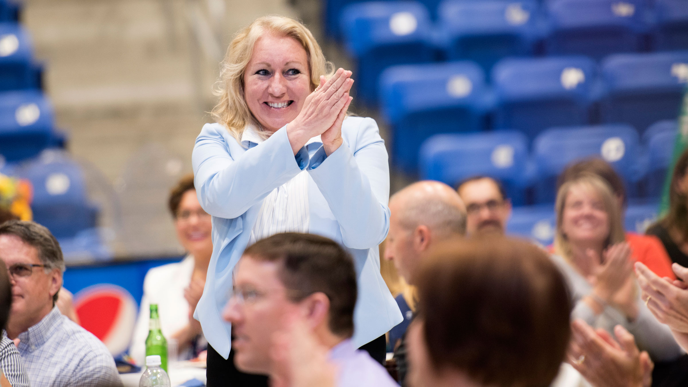 Janice Wachtarz smiles as the crowd around her claps during the Employee Recognition & Retiree Reception event.